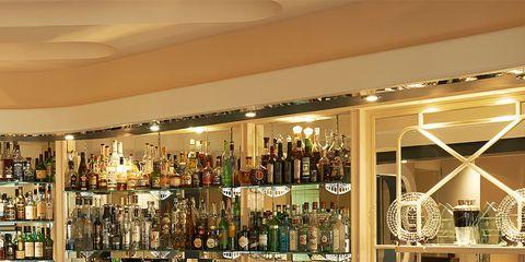 Barware, Alcohol, Bottle, Alcoholic beverage, Drink, Glass bottle, Glass, Drinking establishment, Distilled beverage, Interior design,