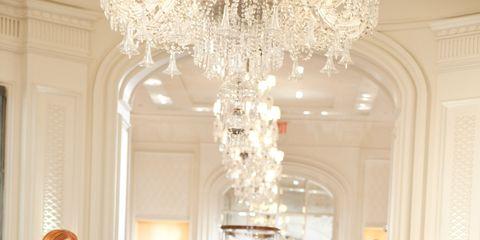 Clothing, Leg, Dress, Shoulder, Outerwear, Ceiling fixture, Interior design, Formal wear, Light fixture, Style,