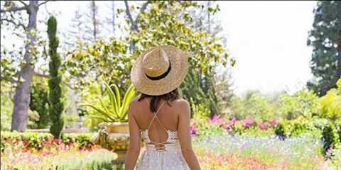 Hat, Plant, Dress, People in nature, Sun hat, Shrub, One-piece garment, Waist, Costume accessory, Day dress,