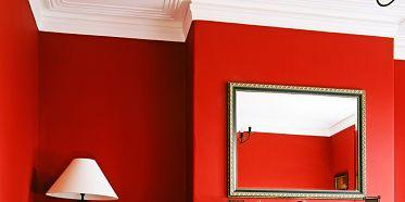 Room, Interior design, Floor, Red, Living room, Home, Wall, Hearth, Furniture, Flooring,