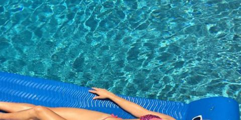 Blue, Fun, Swimwear, Human leg, Brassiere, Leisure, Swimsuit top, Bikini, Summer, Aqua,