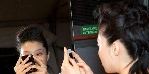 Hair, Ear, Finger, Hairstyle, Eyebrow, Eyelash, Wrist, Mobile phone, Nail, Sweater,