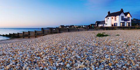 Coastal and oceanic landforms, Window, Shore, Coast, Pebble, Horizon, Real estate, Ocean, House, Azure,