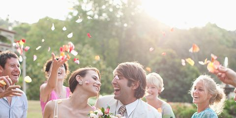 Smile, Dress, Trousers, Petal, Event, Bouquet, Bridal clothing, Photograph, Happy, Wedding dress,