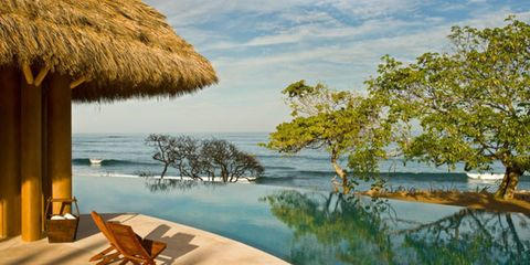 Body of water, Water, Natural landscape, Thatching, Bank, Sunlounger, Outdoor furniture, Shore, Wetland, Tropics,