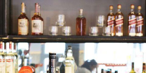 Glass bottle, Bottle, Alcohol, Drink, Alcoholic beverage, Barware, Liquid, Drinkware, Bottle cap, Glass,