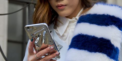 Textile, Wool, Fur clothing, Street fashion, Fur, Electric blue, Gadget, Woolen, Natural material, Telephony,