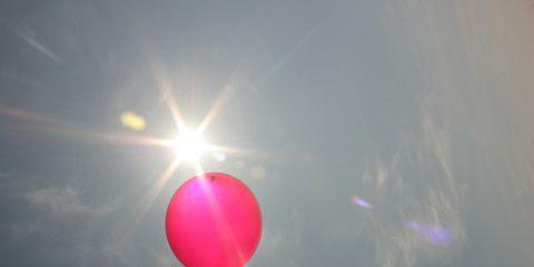 Daytime, Atmosphere, Balloon, Sun, Sunlight, Lens flare, Colorfulness, Light, Magenta, Air sports,