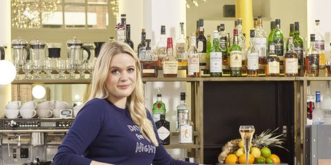 Bottle, Sitting, Drink, Glass bottle, Shelf, Foot, Distilled beverage, Countertop, Alcohol, Shelving,