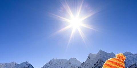 Sun, Winter, Mountainous landforms, Mountain range, People in nature, Lens flare, Slope, Mountain, Sunlight, Glacial landform,
