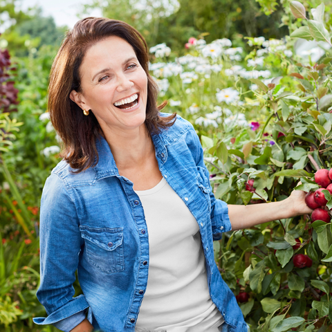 Smile, Shirt, Denim, Happy, Fruit tree, People in nature, Produce, Fruit, Jacket, Shrub,
