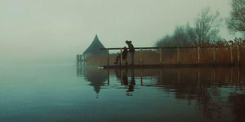Body of water, Human, Water resources, Atmospheric phenomenon, Reflection, Morning, Lake, Dock, Fisherman, Haze,