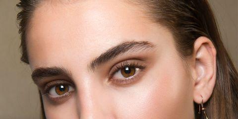 Head, Nose, Lip, Cheek, Finger, Brown, Hairstyle, Skin, Earrings, Chin,