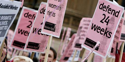 Protest, People, Pink, Public event, Demonstration, Rebellion, Event, Crowd, Photo caption, Smile,