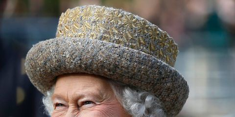 Facial expression, Smile, Hat, Human, Headgear, Fashion accessory, Tradition, Happy, Wrinkle, Ear,