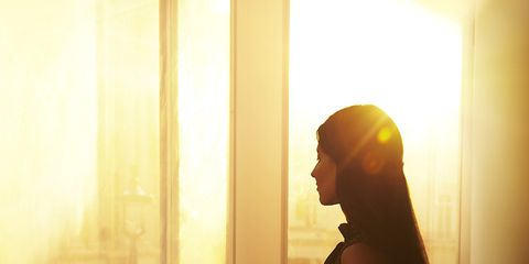Yellow, Shoulder, Standing, Dress, Sunlight, Amber, Backlighting, Light, Fixture, Tints and shades,