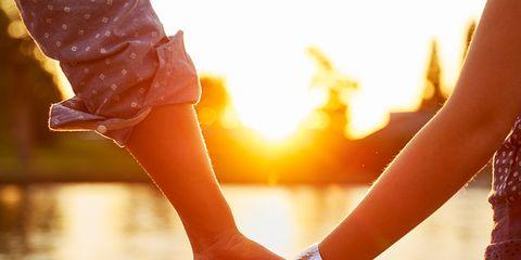 People in nature, Holding hands, Water, Orange, Hand, Gesture, Interaction, Love, Sunlight, Sky,