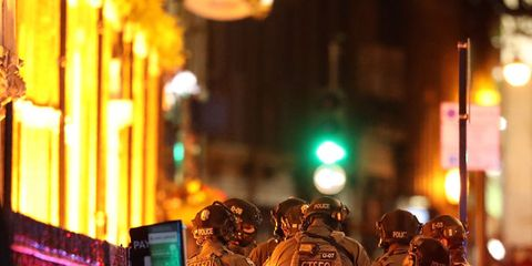 Lighting, Night, Standing, Emergency service, Amber, Interaction, Emergency, Police, Metropolitan area, Helmet,