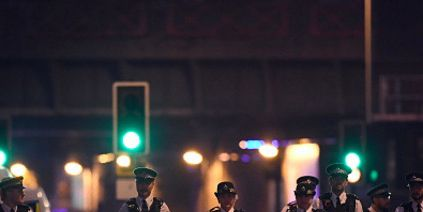 Night, Standing, Uniform, Police, Police officer, Midnight, Law enforcement, Official, Security, Electricity,