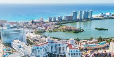 City, Human settlement, Metropolitan area, Real estate, Tourism, Resort town, Building, Condominium, Coast, Sea,