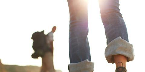 Pebble, Walking, Human leg, Sand, Leg, Fun, Hand, Friendship, Human, Joint,