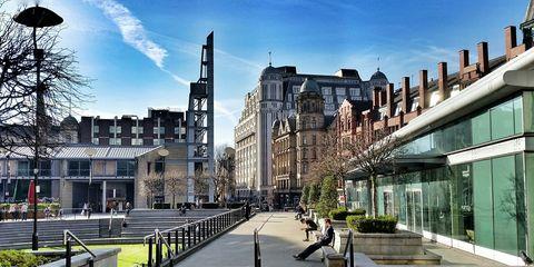 Architecture, Building, Town, Mixed-use, Metropolitan area, Urban area, City, Human settlement, Sky, Tree,