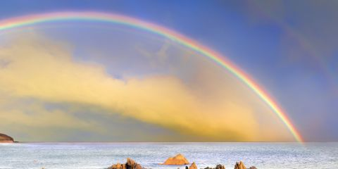 Rainbow, Sky, Body of water, Nature, Sea, Natural landscape, Coast, Ocean, Cloud, Rock,