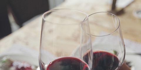 Wine glass, Stemware, Red wine, Drink, Wine, Glass, Champagne stemware, Alcoholic beverage, Wine tasting, Hand,