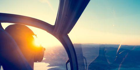 Sky, Air travel, Blue, Airline, Cloud, Aerospace engineering, Atmosphere, Sunlight, Mountain, Wing,