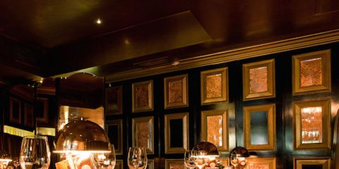 Lighting, Room, Restaurant, Interior design, Building, Bar, Table, Barware, Furniture, Wine glass,