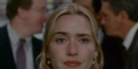 Hair, Face, Facial expression, Blond, Eyebrow, Hairstyle, Suit, Chin, Nose, Smile,