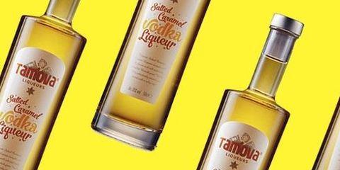 Liqueur, Glass bottle, Product, Bottle, Yellow, Distilled beverage, Drink, Alcoholic beverage, Dessert wine,