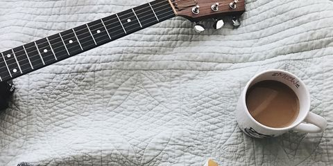 Guitar, String instrument, Plucked string instruments, Design, Musical instrument, Ukulele, Material property, Font, Fashion accessory, Pattern,