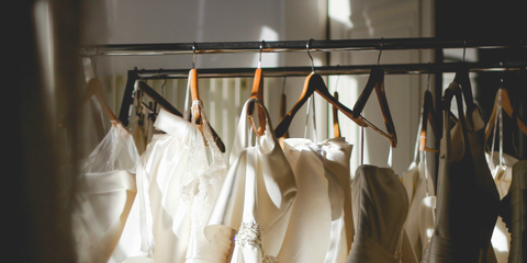 White, Clothes hanger, Clothing, Dress, Bridal clothing, Gown, Wedding dress, Room, Fashion design, Dry cleaning,