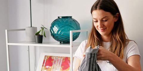 Room, Textile, T-shirt, Shelf, Fashion design, Furniture, Interior design, Laundry, Linens, Small appliance,