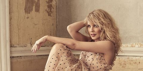 Photograph, Sitting, Beauty, Long hair, Leg, Dress, Blond, Hairstyle, Human leg, Shoulder,