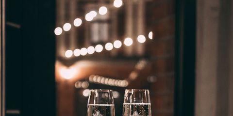 Stemware, Wine glass, Drinkware, Drink, Glass, Champagne stemware, Tableware, Table, Restaurant, Still life photography,