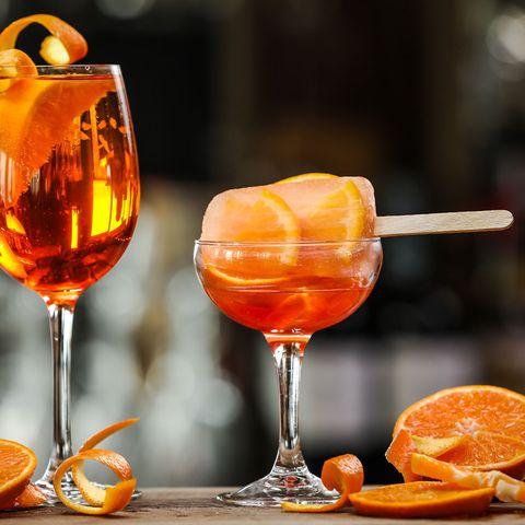 Glass, Orange, Barware, Tableware, Stemware, Drink, Amber, Drinkware, Alcoholic beverage, Ingredient,