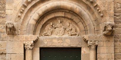 Door, Wall, Home door, Fixture, Arch, Relief, Door handle, History, Stone wall, Ancient history,