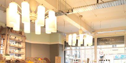 Lighting, Interior design, Furniture, Light fixture, Table, Ceiling, Restaurant, Ceiling fixture, Interior design, Chandelier,