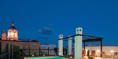 Lighting, Property, Swimming pool, Real estate, Fluid, Aqua, Resort, Turquoise, Azure, Teal,
