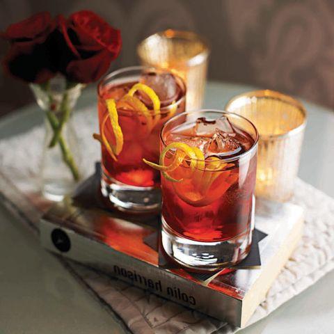 Drink, Distilled beverage, Alcoholic beverage, Liqueur, Amaretto, Negroni, Old fashioned glass, Alcohol, Shot glass, Whisky,