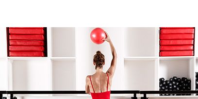 Shoulder, Room, Elbow, Red, Standing, Active pants, Human leg, Waist, Exercise, Wrist,