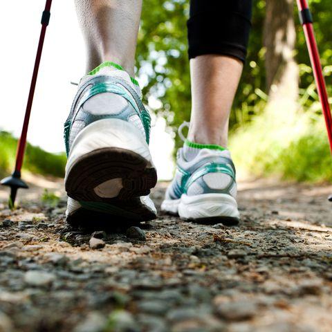 Green, Footwear, Walking, Human leg, Shoe, Leg, Trail, Nordic walking, Ankle, Joint,