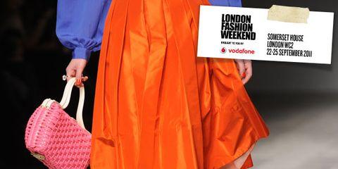 Clothing, Yellow, Sleeve, Orange, Red, Textile, Human leg, Bag, Style, Pattern,