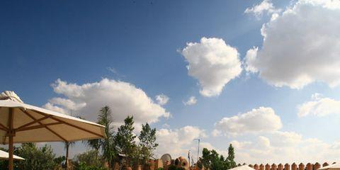 Cloud, Flowerpot, Resort, Wicker, Outdoor table, Outdoor furniture, Shade, Garden, Outdoor structure, Basket,
