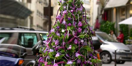 Land vehicle, Christmas decoration, Fender, Purple, Magenta, Alloy wheel, Auto part, Holiday, Christmas ornament, Parking,