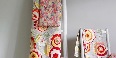 Textile, Pattern, Linens, Cushion, Creative arts, Pillow, Visual arts, Design, Throw pillow, Motif,