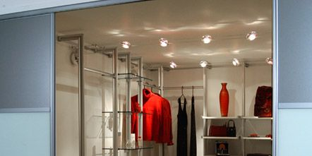 Floor, Room, Flooring, Clothes hanger, Closet, Hardwood, Outlet store, Wood flooring, Boutique, Laminate flooring,