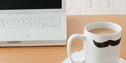 Coffee cup, Cup, Serveware, Drinkware, Dishware, Doughnut, Ingredient, Office equipment, Table, Cuisine,